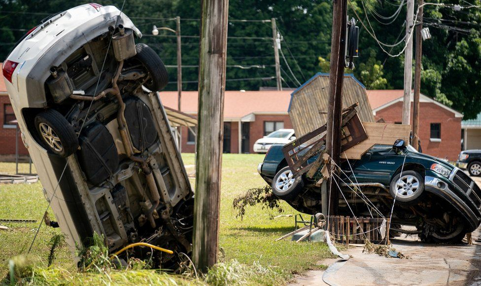 Vehicles left damaged in the wake of heavy flood waters in Waverly, Tennessee, US, 22 August 2021