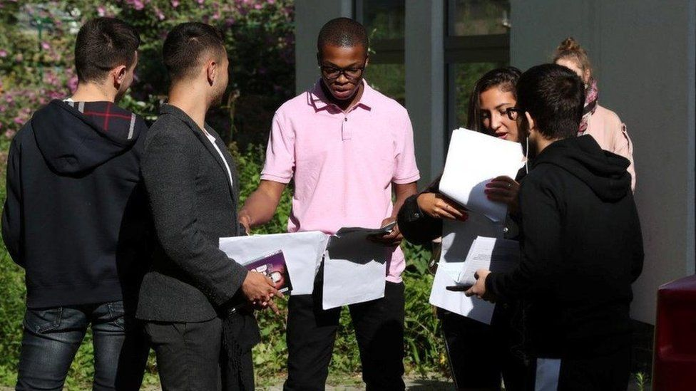Students at Ark Academy in Wembley, north London, discuss their results