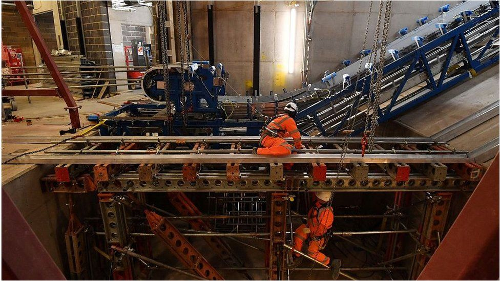 Workmen installing escalators on Crossrail
