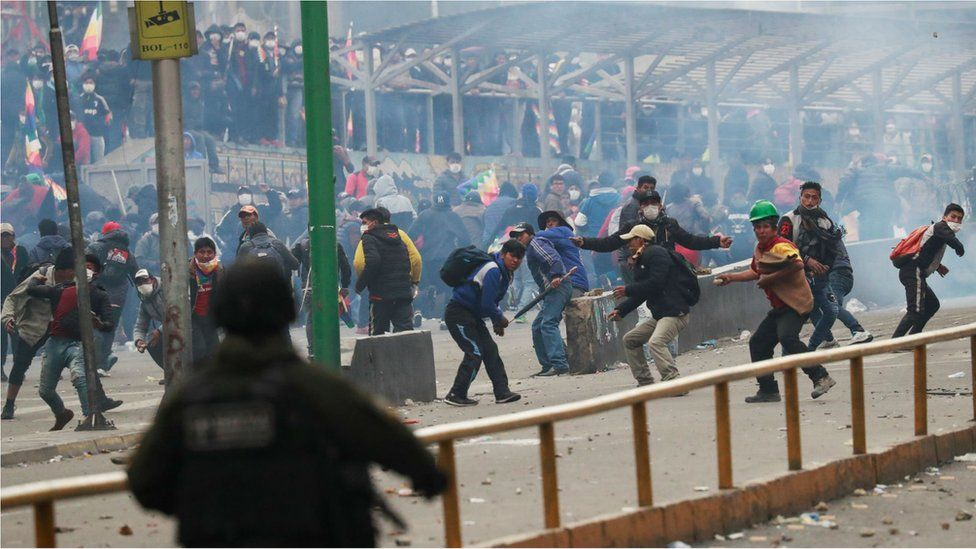 Security forces and supporters of former Bolivian President Evo Morales clash in La Paz, Bolivia, 14 November, 2019.