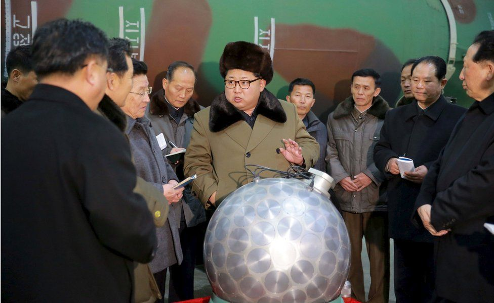 North Korean leader Kim Jong-un stands next to what purports to be a nuclear weapon, surrounded by scientists and technicians. An undated photo released by North Korea's Korean Central News Agency (KCNA) in Pyongyang on 9 March 2016.