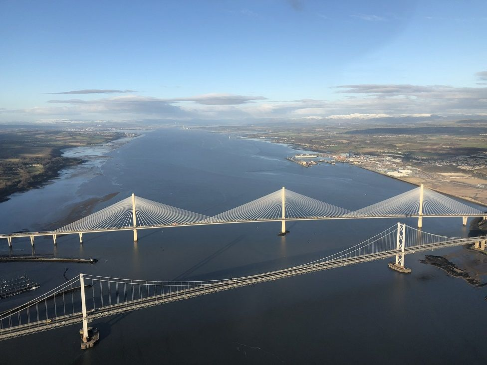 Aerial photograph of old Forth Road Bridge and Queensferry Crossing.
