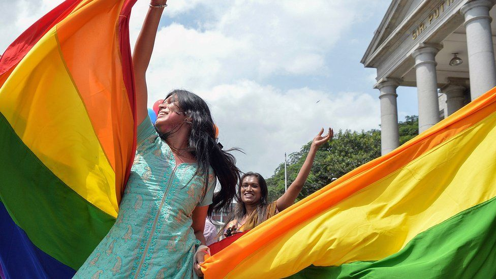 Women celebrate after the Indian Supreme Court struck down a law which criminalised gay sex