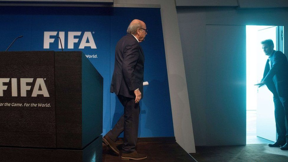 Fifa President Sepp Blatter leaves after a news conference