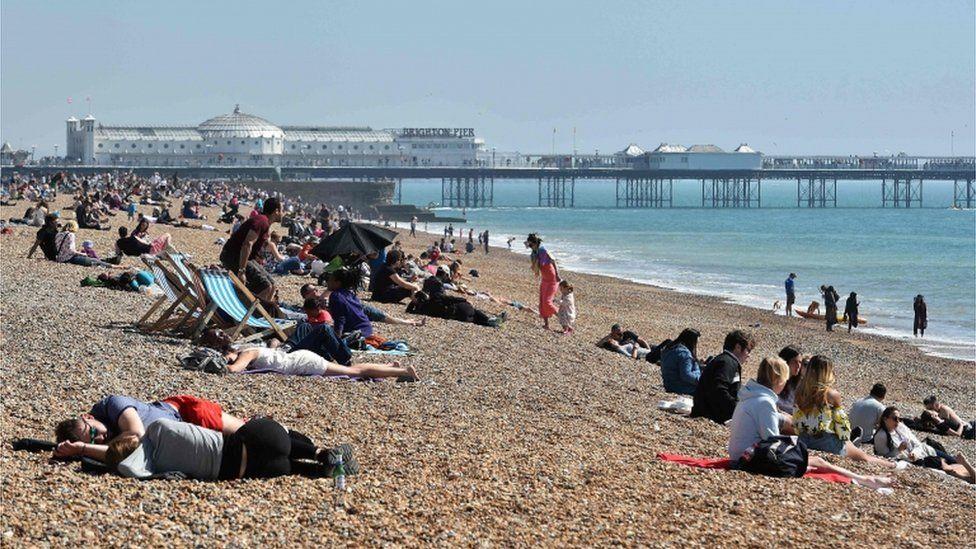 People lying on Brighton beach