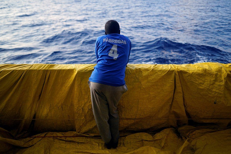 Yuosef, 28, from Sudan, stands on board NGO Proactiva Open Arms rescue boat in central Mediterranean Sea