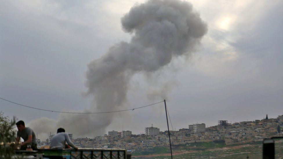 Smoke rises from the Syrian city of Afrin following an explosion on 18 March 2018