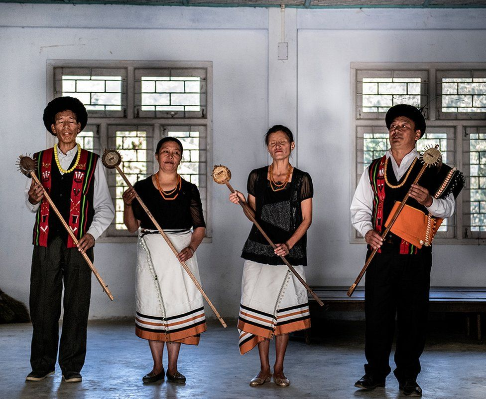 The village members are seen practicing folk music.