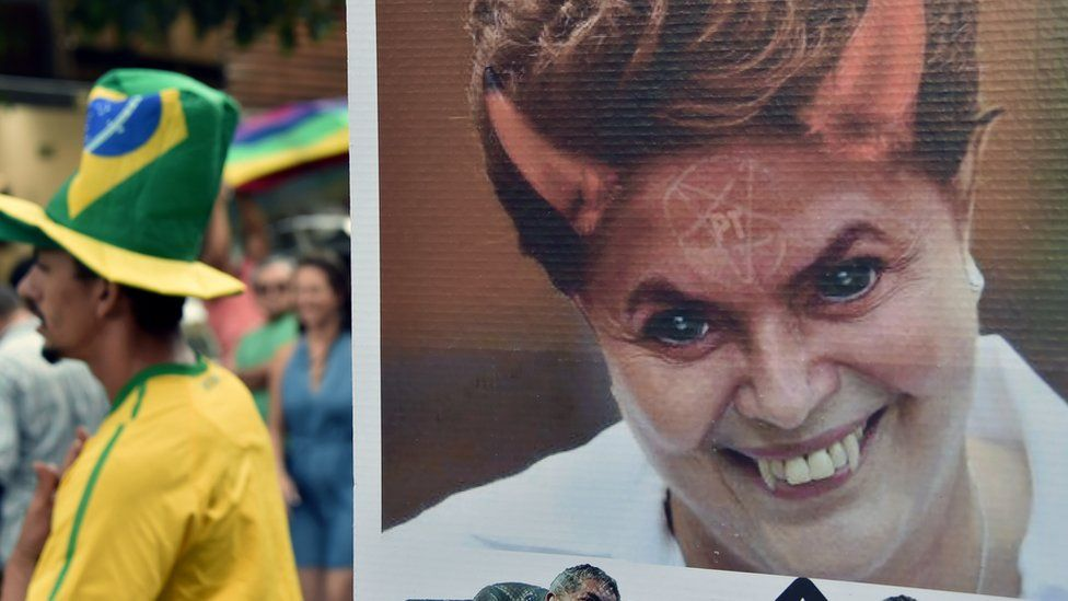 View of a poster depicting Brazilian President Dilma Rousseff as a devil during a demo in support of her impeachment in Sao Paulo, Brazil on April 17, 2016