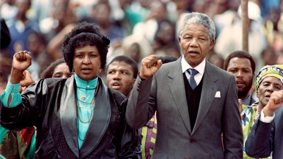 Winnie and Nelson Manela with their fists raised at Soweto Soccer Stadium in 1990