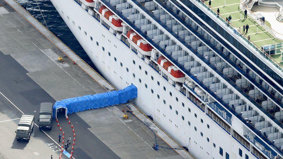 Passengers disembarking from the Diamond Princess cruise ship docked at Yokohama Port are pictured in Yokohama, south of Tokyo