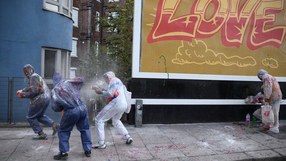 """Paint-covered revellers take part in the traditional """"Jouvert"""" opening parade of the Notting Hill carnival"""