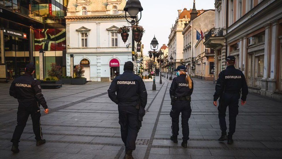 Serbian police have been out in Belgrade enforcing a curfew