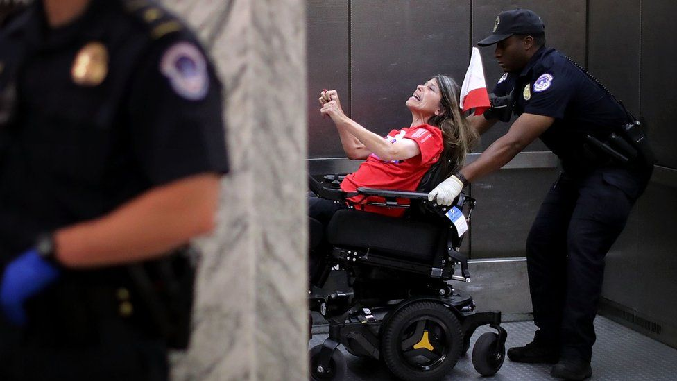 US Capitol Police arrest protesters who shouted and interrupted a Senate Finance Committee