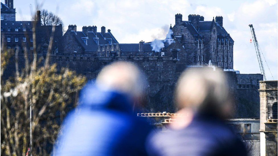 people watching Edinburgh Castle gun salute