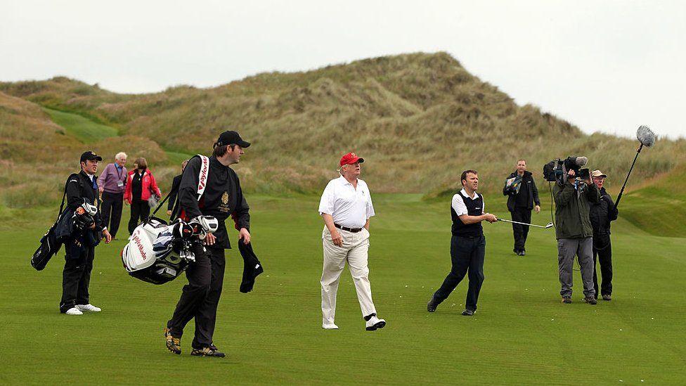 Donald Trump walks on his golf course in Balmedie, Scotland.