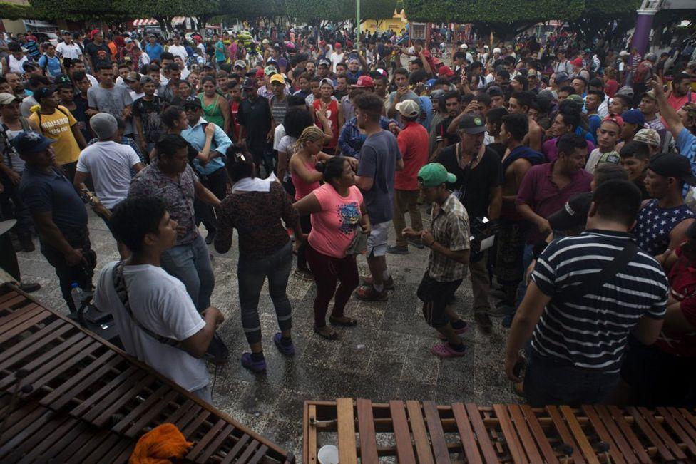 Migrants dance was local musicians play music in the central square of Ciudad de Hidalgo