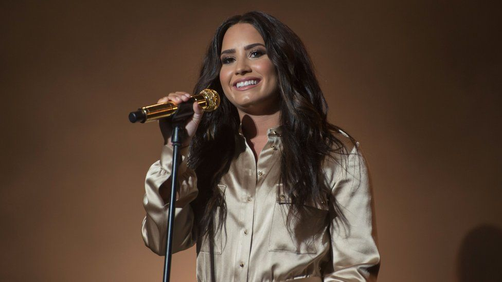 Lovato performing on stage in 2017 in Morocco