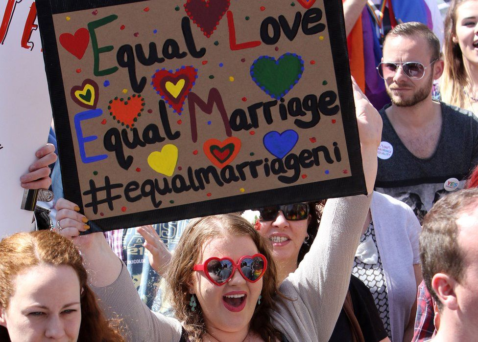 """A sign from a pro-gay marriage march in Belfast last year saying: """"equal love, equal marriage"""""""