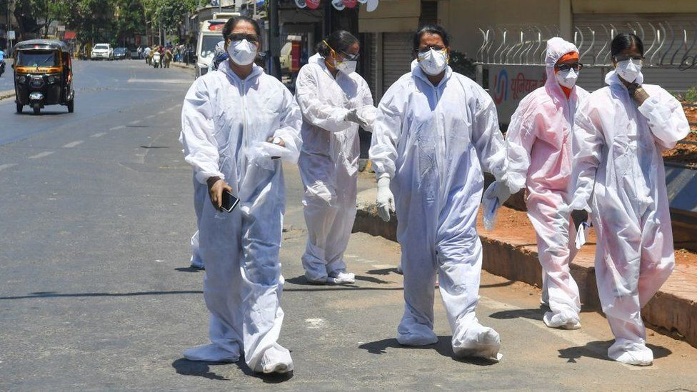 Health workers take a break in Mumbai