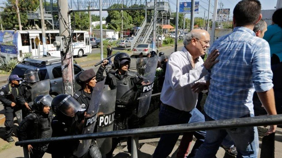Riot police clear journalists from an area near a police station in Managua, Nicaragua. Photo: 15 December 2018