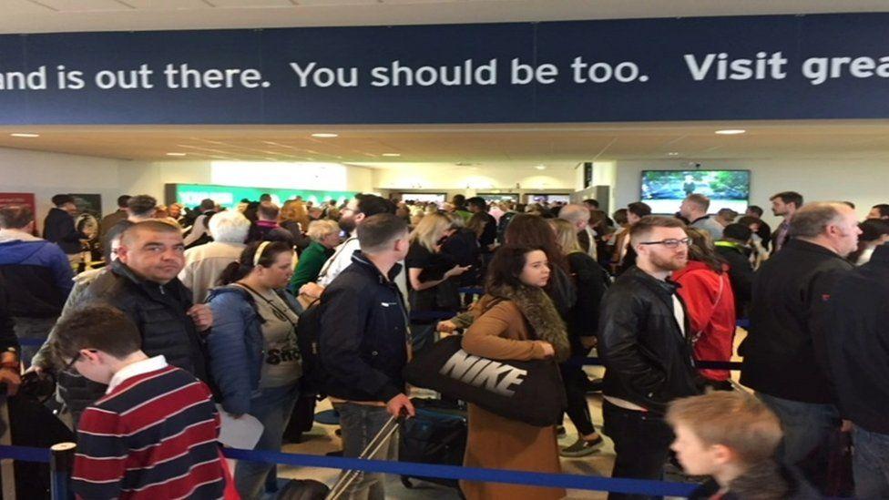 A queue of passengers at Belfast International