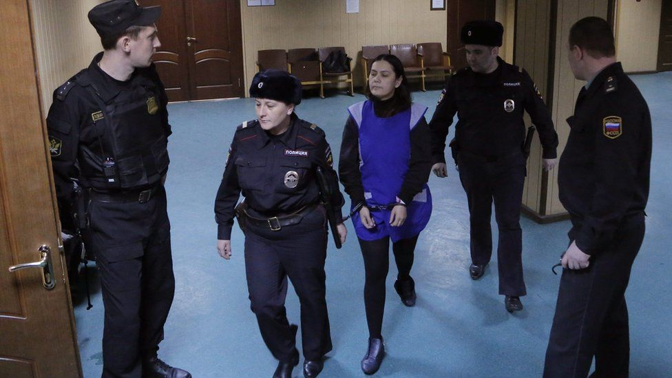 Gyulchehra Bobokulova (C) is escorted to attend a hearing at the Presnensky district court in Moscow, Russia, 02 March 2016.