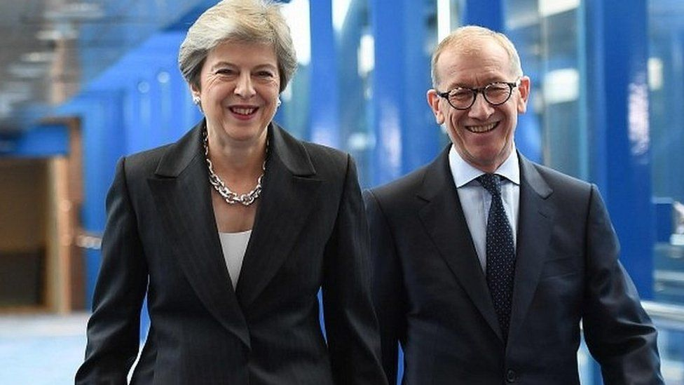 Theresa May with her husband Philip arriving at the conference venue