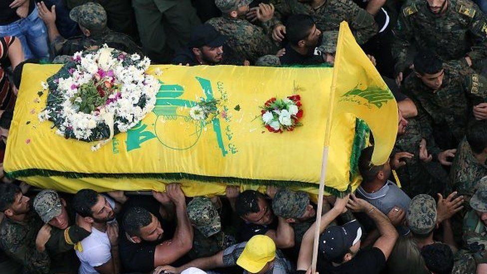 Members of Lebanon's Shia movement Hezbollah carry the coffin of a comrade killed in fighting near Zabadani