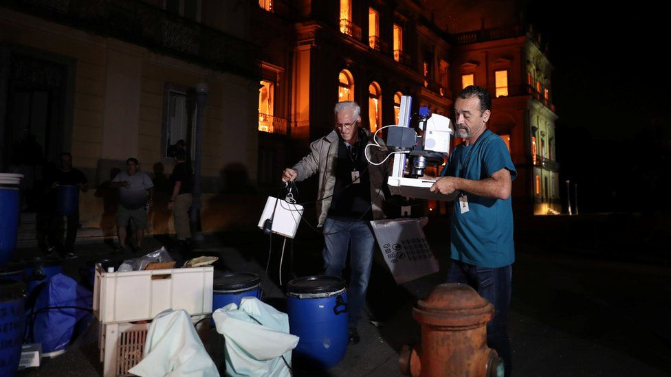 People rescue items during a fire at the National Museum of Brazil in Rio de Janeiro, Brazil on 2 September 2018.
