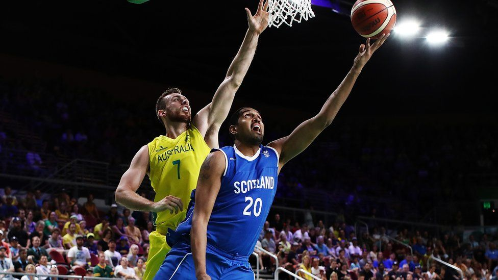 Kieron Achara of Scotland shoots as Nicholas Kay of Australia defends at the 2018 Commonwealth Games