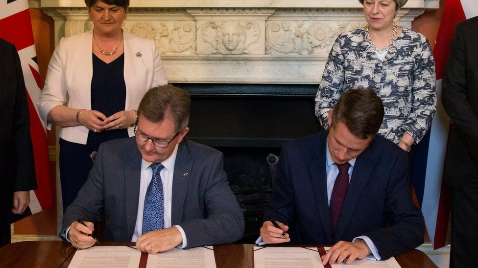 The deal was signed in Downing St by DUP MP Sir Jeffrey Donaldson and Tory Chief Whip Gavin Williamson