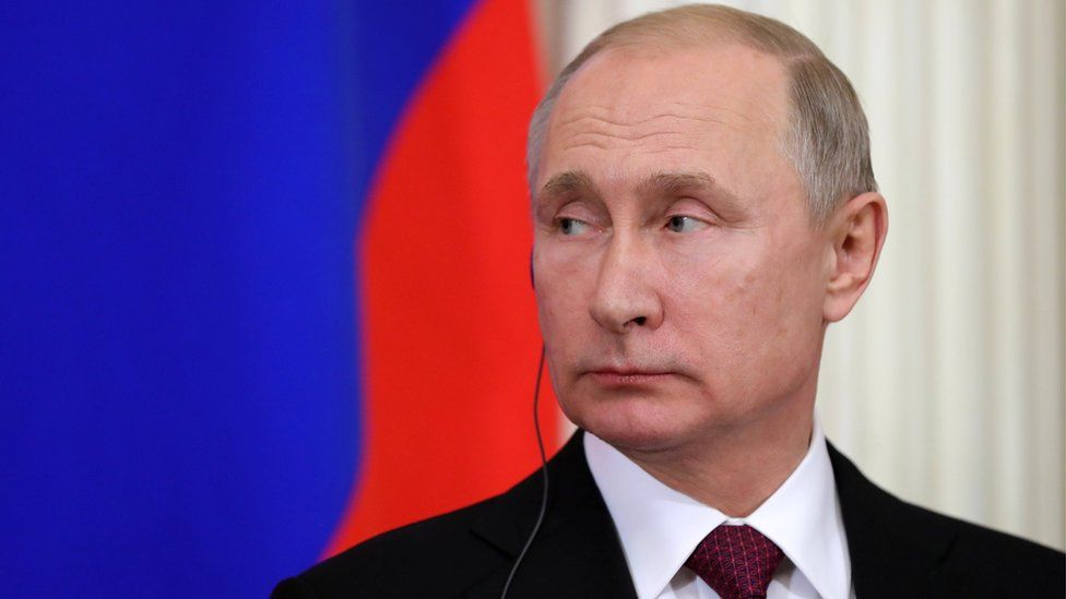 Russian President Vladimir Putin attends a joint news conference on 23 January