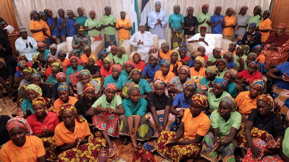 Nigeria's President Muhammadu Buhari applauds as he welcomes a group of Chibok girls, who were held captive for three years by the millitant group Boko Haram, in Abuja, Nigeria, May 7, 2017