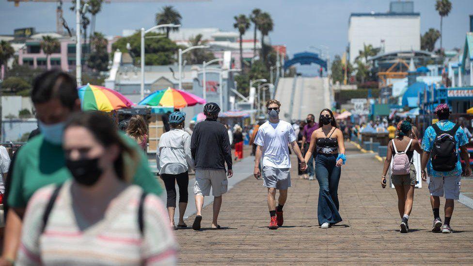 People walk outside in Santa Monica