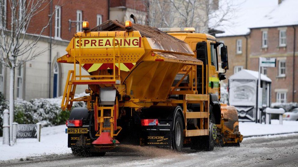 gritter on road with snow