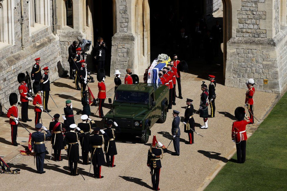 The Duke of Edinburgh's coffin, covered with His Royal Highness's Personal Standard is carried to the purpose built Land Rover during the funeral of Prince Philip, Duke of Edinburgh at Windsor Castle on April 17, 2021