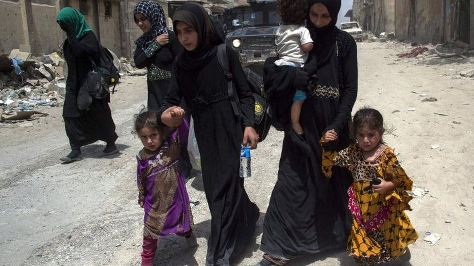 Women and children flee Mosul's Old City. Photo: 3 July 2017