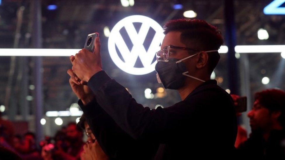 A visitor wears a mask as a precautionary measure against Corona virus at the Volkswagen showcasing hall during the India Auto Expo 2020 in Greater Noida, India, 05 February 2020.