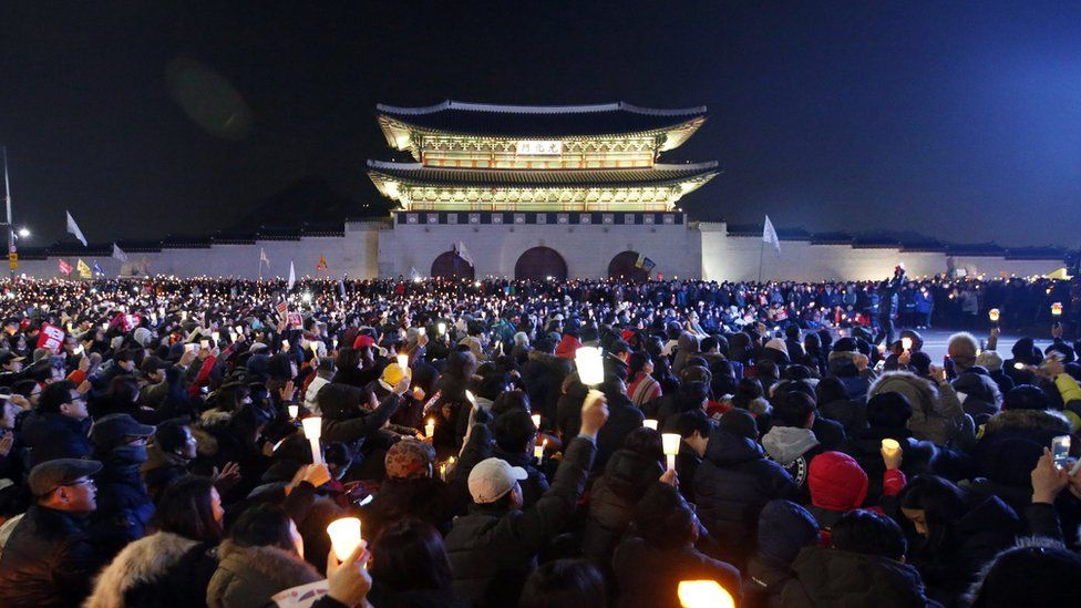 South Koreans attend a candlelight protest during a rally against president Park Geun-hye