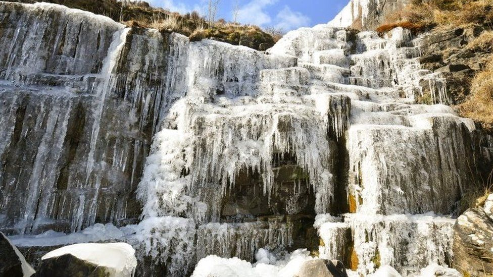 Icicles formed on a frozen waterfall near Pen y Fan mountain on Brecon Beacon National Park, Wales,
