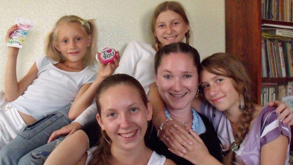 Dr Rachel Furley and members of the Kartuzovi family