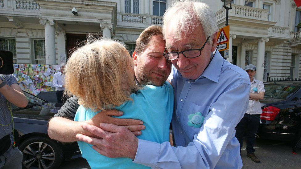 Richard Ratcliffe, the husband of detained Nazanin Zaghari Ratcliffe, is embraced by his mother and father outside the Iranian Embassy in Knightsbridge