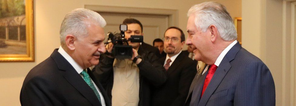 US Secretary of State Rex Tillerson (R) shakes hands with Turkish Prime Minister Binali Yildirim (L)