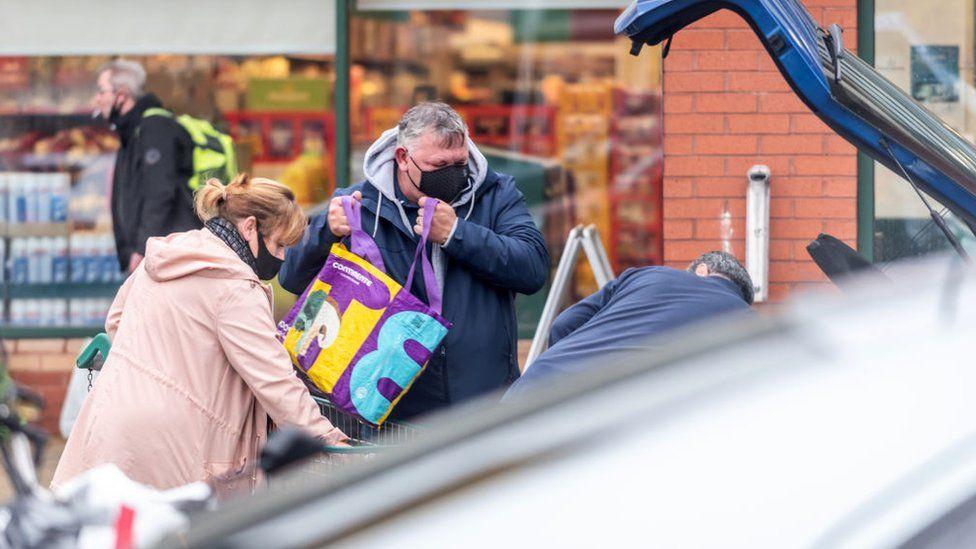Christmas shoppers outside a Morissons store