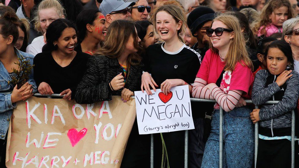 Signs held up for the arrival of the Duke and Duchess of Sussex