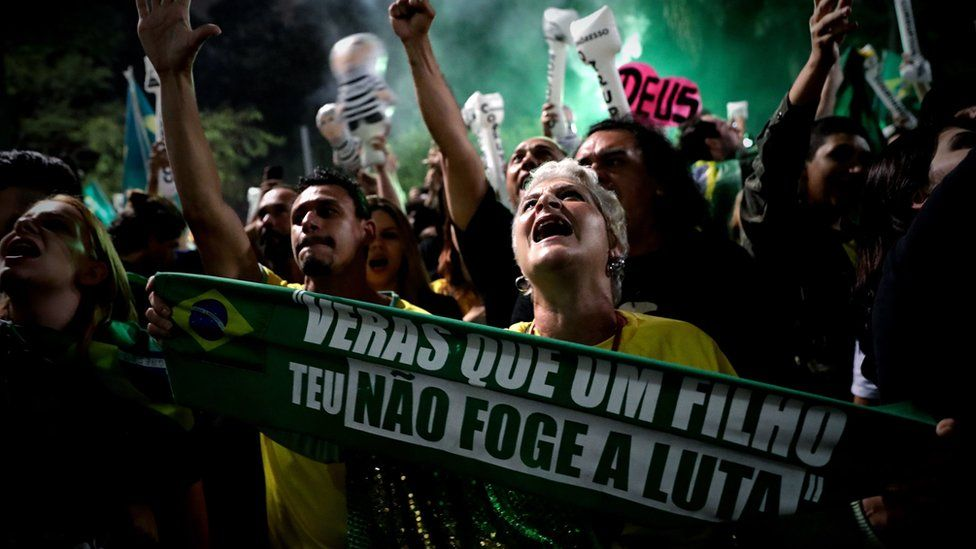Supporters of Brazilian far-right presidential candidate Jair Bolsonaro celebrate his victory at the Paulista Avenue, in Sao Paulo, Brazil, 28 October 2018.