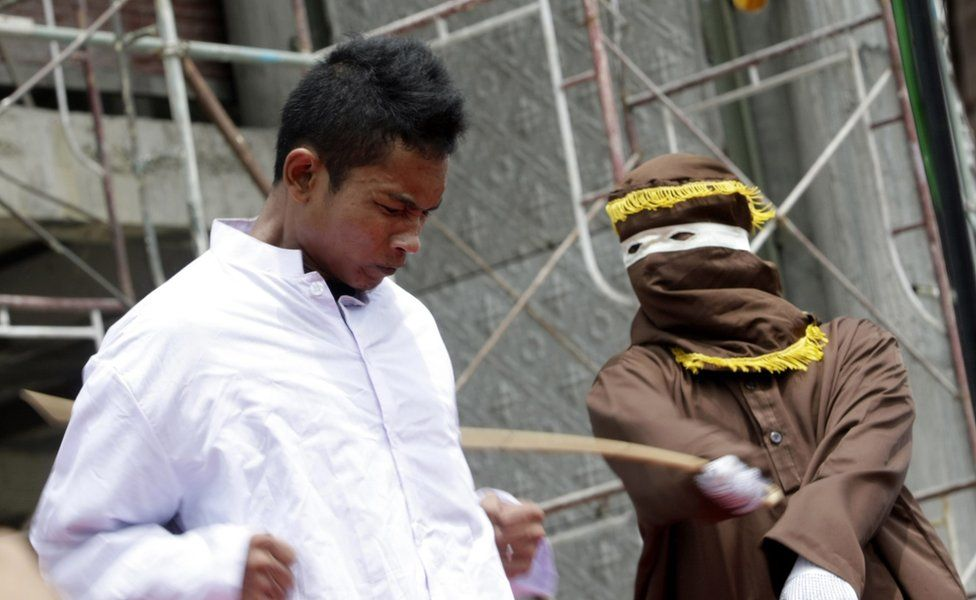 A man is caned for violating Sharia law