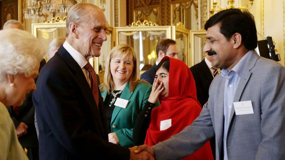 Malala Yousafzai and other guests meeting the Queen and Duke of Edinburgh