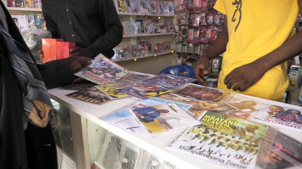 People at a pirated CD and DVD shop in Malawi